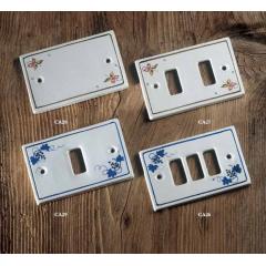 Plaque d'interrupteurs en céramique peints à la main